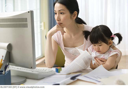 Asian mother working at home with baby