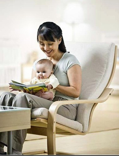 Asian mother reading to baby