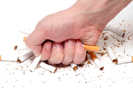 Man trying to give up smoking. Conceptual image.