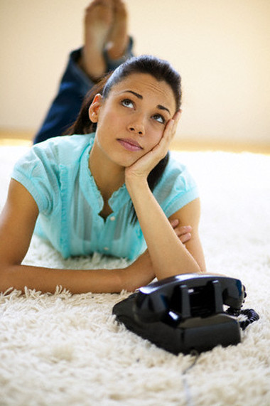 Young Woman Waiting Beside Telephone